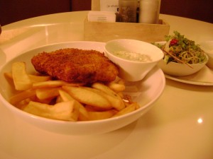 Fillet of fish, with chips and salad