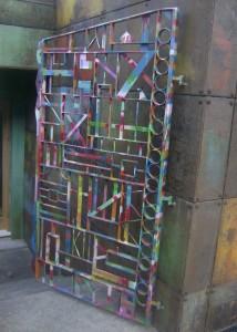 Multi-coloured gate on a house near Lyall Bay