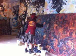 Chris Rutterford Painting a Mural