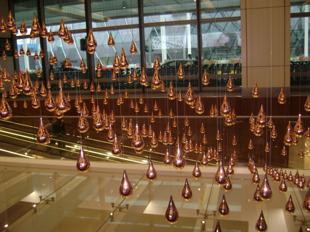 Beads of copper in Kinetic Rain Exhibit, Singapore Airport