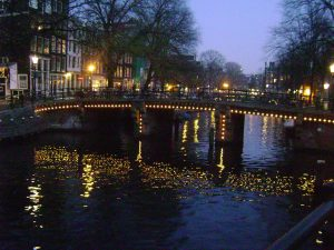 Picture showing lit up bridge in Amsterdam